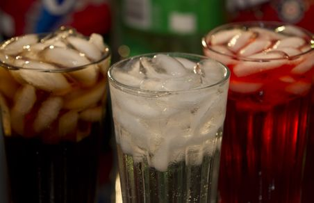 Soft_Drinks_in_Glass_with_Bottles_926f0c15-b214-4abb-9bea-2dfe2f519478-prv